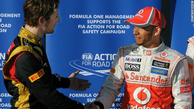 Lotus' Romain Grosjean, left, congratulates Lewis Hamilton after the McLaren driver earns pole position at Albert Park.