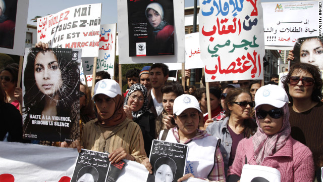 Women protesting in Rabat hold posters of Amina Filali, 16,who was forced to marry the man alleged to have raped her.