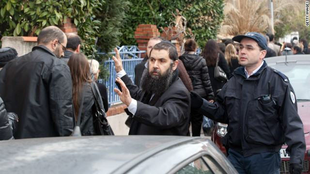Rabbi Rav Gabriel directs families to the scene of the fatal shooting on Monday. France, which has one of the largest Jewish populations in Europe, had 389 reported acts of anti-Semitism in 2011, according to Representative Council of Jewish Institutions in France.