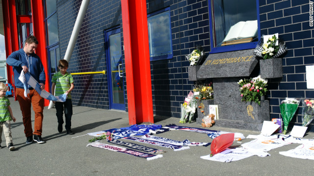 Bolton Wanderers fans have left flowers and scarves outside the English club's Reebok Stadium in support of Muamba, while most of the playing<br /> 1000<br />  squad have been to visit him in the London Chest Hospital.