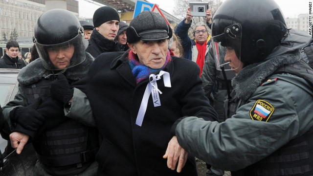 Russian riot policemen detain a protestor during a demonstration outside Ostankino TV Center in Moscow on March 18, 2012.