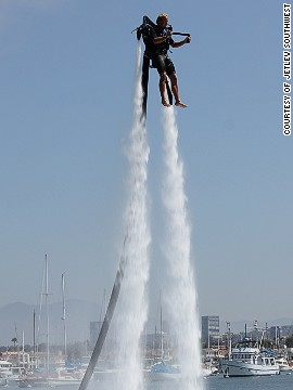 "A man tries out the Jetlev water jet pack. First-time ""flyers"" can reach up to 15 feet; the jet pack can propel flyers a maximum of 30 feet high."