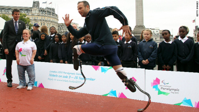 Pistorius demonstrates his sprinting skills to London Olympic chief Sebastian Coe at an event to launch the 2012 Paralympic Games.