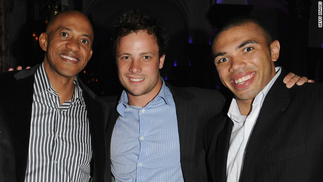 Pistorius with one of his sporting heroes, Namibian sprint star Frankie Fredericks, and South African rugby player Bryan Habana, right.