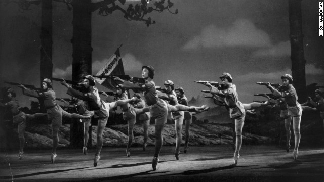 "Dancers from ""The Modern Ballet of the Revolution"" aim their rifles during a scene from a revolutionary ballet performance in Peking, 1971."