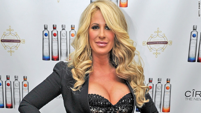 """Real Housewives of Atlanta"" star Kim Zolciak was accused of being tardy with the money in March 2013 by fellow cast member Kandi Burruss and producer Don Vito. The pair accused her of denying them payment and rights to her single ""Tardy for the Party."" Zolciak released a statement denying the claims."