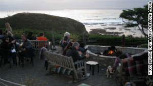 Moss Beach Distillery\'s Seal Cove Patio invites dogs to cozy up by the fire pit and dine on grilled hot dogs.