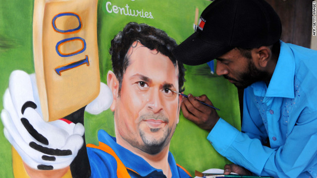 Indian painter Jagjot Singh Rubal touches up his painting commemorating Tendulkar's famous cricketing milestone.
