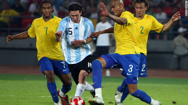 Anderson, left, and his Brazil teammates try to take the ball off Lionel Messi in the 2008 Olympic semifinal against Argentina, who won 3-0 and went on to take gold.