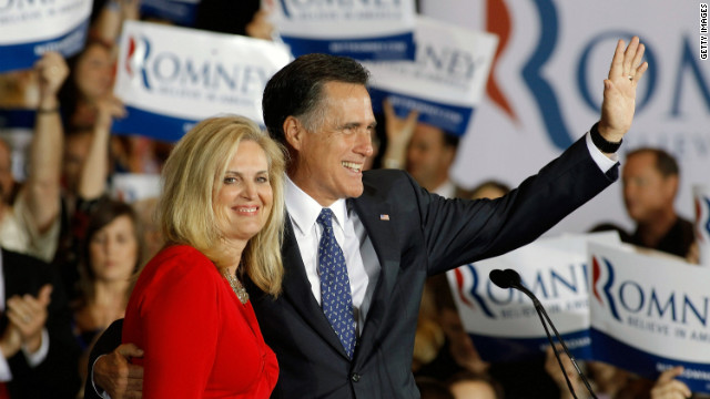 Mitt Romney and wife Ann celebrate his apparent victory Tuesday in the Illinois primary.