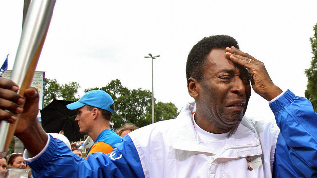Brazil football legend Pele sheds tears as he carries the torch for the 2008 Beijing Olympics on its visit to Rio. Brazil will host the Summer Games in 2016.