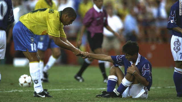 "However, Olympic success has eluded the ""Samba Boys."" Ronaldo, here helping a Japan player to his feet during Brazil's 1-0 loss, won a bronze medal at Atlanta 1996. He went on to win the World Cup in 2002 and become the tournament's record overall scorer."