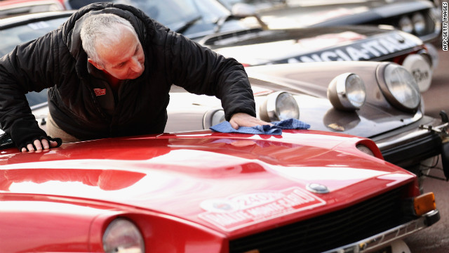Paul Chilton polishes a Datsun 240z prior to the Monte Carlo Rally on January 27, 2011 in Glasgow, Scotland.