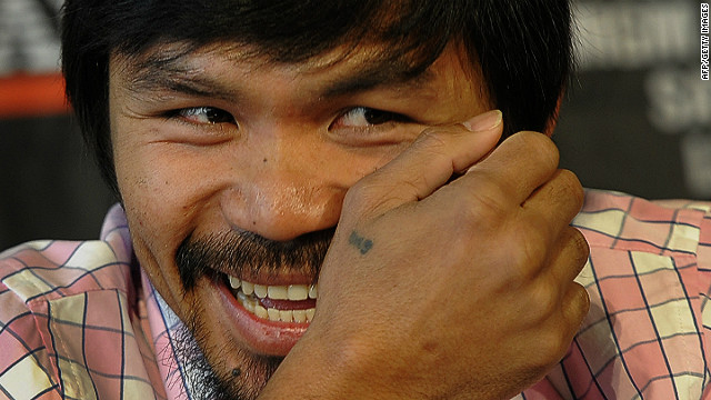 Pacquiao's team says the Filipino boxer is unlikely to retire this year or next
