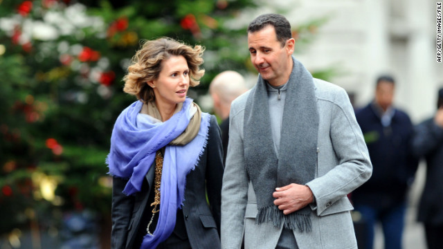 Syrian President Bashar al-Assad and his wife, Asma, walk along a Paris street in 2010. The couple share flirtatious e-mails.