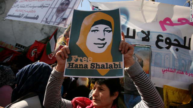Palestinian women hold up a portrait of Hana al-Shalabi during a demonstration to demand her release on March 8, 2012.