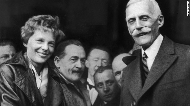 Andrew Mellon, U.S. ambassador to Britain, greets Earhart in Northern Ireland after her historic transatlantic flight.