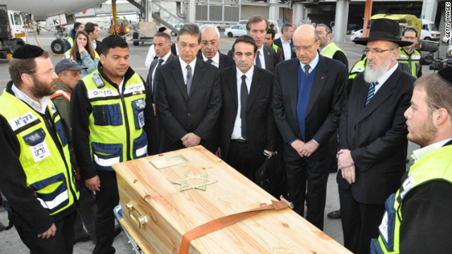 The coffins containing the bodies of the victims of the shooting at the Ozar Hatorah Jewish school arrive at Ben Gurion Airport, Israel from France on March 20. They are buried in Jerusalem on Wednesday. 