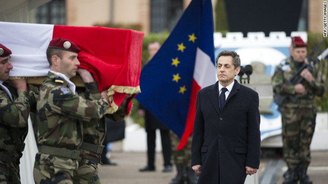 French President Nicolas Sarkozy watches March 21 as soldiers carry the coffin of a paratrooper killed by the Toulouse gunman. 