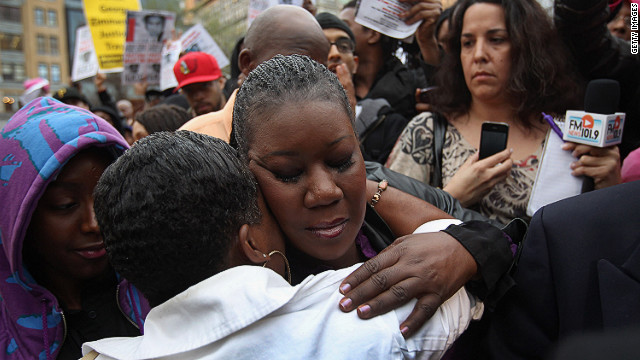 "Sybrina Fulton, Trayvon's mother, hugs a supporter at the March. ""Our son is your son,"" Fulton, told the crowd. ""This is not about a black-and-white thing. This is about a right-and-wrong thing. Justice for Trayvon!"""