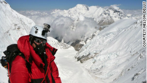Dellis climbs Mt. Everest in May 2011. Through his charity, he climbs mountains to raise money for Alzheimer\'s disease research.