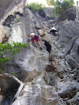 Rock climbers scale two routes on Moody's Beach in Halong Bay in Vietnam.