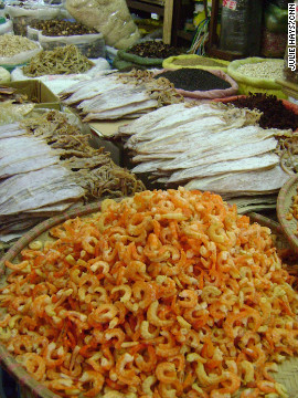 A seafood stall displays plates of dried shrimp and squid at a market in Hanoi's Old Quarter. 