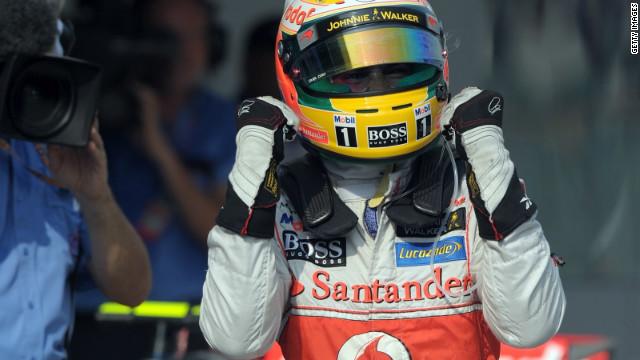 A jubilant Lewis Hamilton celebrates his pole position at Sepang for the Malaysian Grand Prix.