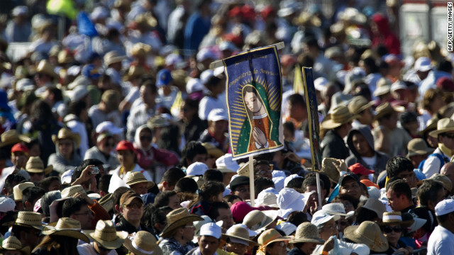 Pilgrims wait for Benedict to arrive at the park on Sunday for the Mass. Many said they had spent the night camped out, awaiting the pope's arrival.