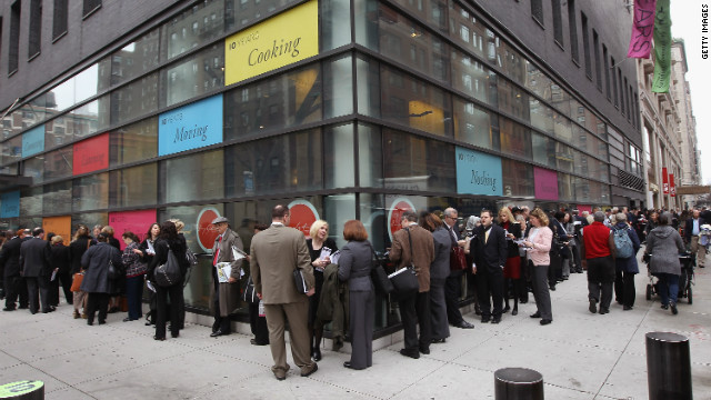 People stand in a line that stretched around the block to enter a job fair on March 21 in New York City.