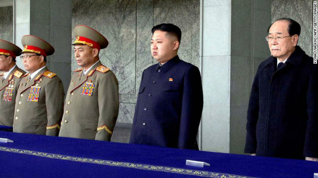 Kim Jong Un (3rd R) attends a memorial service on the 100th day since the death of the late leader Kim Jong Il on March 25.