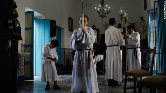 Altar boys prepare for the start of a morning service at Santo Angel Custodio church a day before Pope Benedict XVI is scheduled to arrive in Cuba on Monday.