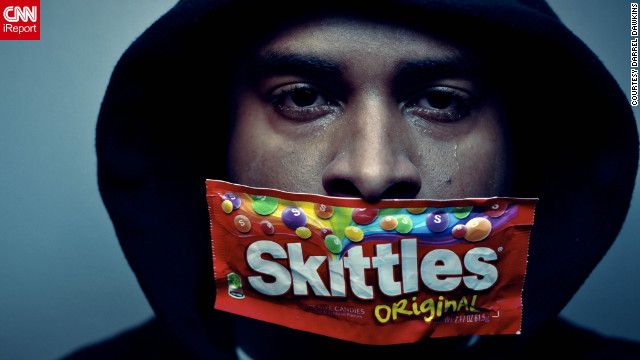 "New York photographer Darrel Dawkins wants to send a message about the Trayvon Martin story, as do many iReporters who shared self-portraits in support of the movement. ""We shouldn't stay silent. We should basically talk about those who are out there discriminating and those who are racist."""