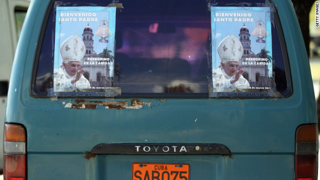 Posters on the back of a van welcome Pope Benedict XVI at Revolution Square in Santiago de Cuba on Monday. 