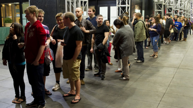 Moviegoers wait in line for the opening of