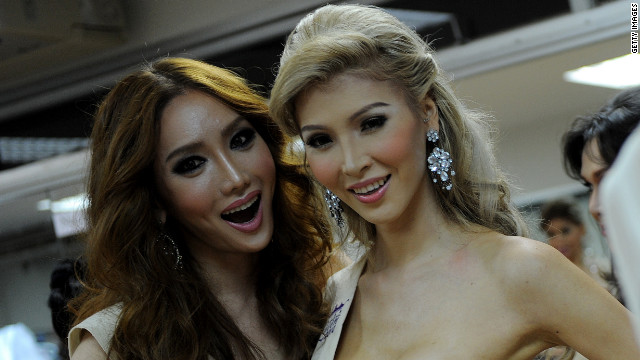 South Korea's Mini, left, joins Canada's Jenna Talackova at the Miss International Queen 2010 transgender beauty pageant.