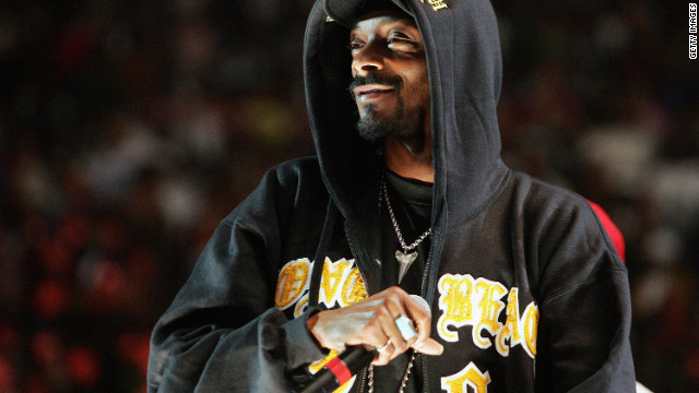 Snoop Dogg performs in a hoodie at New York's Madison Square Garden in November 2004.