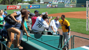 Tampa Bay Rays first baseman Carlos Peña poses with fans during spring training at McKechnie Field.