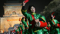 A women's drum troupe perform in front of Beijing's ancient Bell Tower moments before midnight on the eve of the Lunar New Year, 28 January 2006.