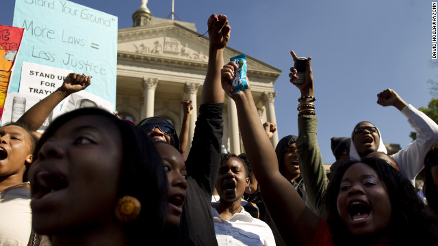 Thousands of protesters gathered at the &quot;I am Trayvon Martin&quot; rally Monday at the state Capitol in Atlanta. Protesters wore hoodies and carried containers of iced tea and bags of Skittles. 