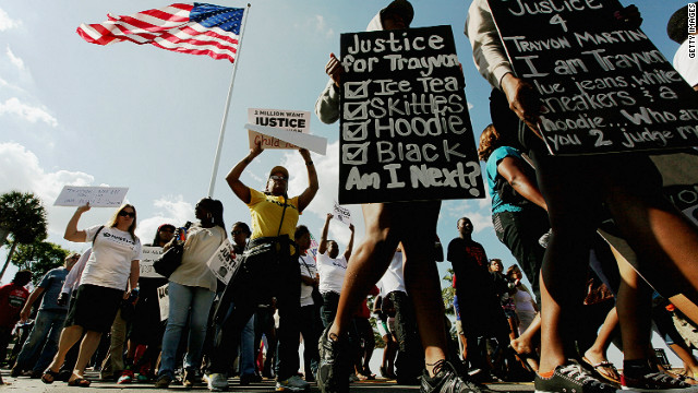 Protesters march in downtown Sanford, Florida, where Trayvon Martin was killed.