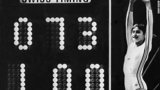 The Perfect 10: Nadia Comaneci celebrates next to the scoreboard after her uneven bars performance at the 1976 Montreal Olympics.
