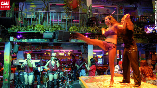Mango's Tropical Cafe hosts a bartop dance show in South Beach.