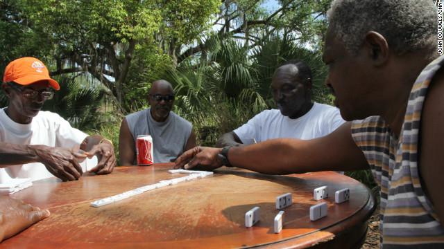 Members of the Goldsboro community play a game under an oak tree. Goldsboro was one of Florida's earliest towns incorporated by African-Americans before Sanford absorbed it and took over in 1911. Residents speak of frequent police patrols in the area and other cases similar to Martin's.