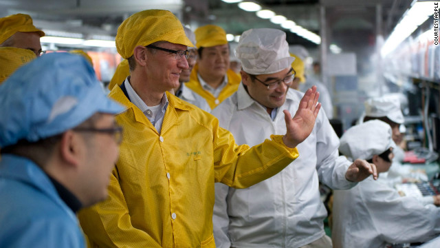 Tim Cook tours a Foxconn plant in Zhengzhou, China, on March 28. The plant's 120,000 workers assemble Apple products.
