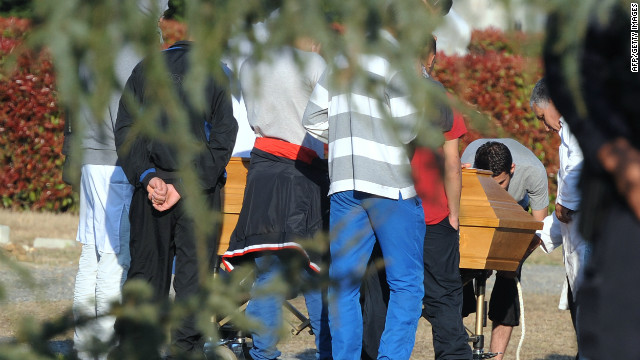 Relatives of Islamist extremist Mohammed Merah attend the burial of his body in a Toulouse cemetery.