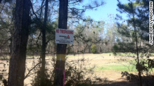 Georgia Power now owns the lot belonging to a cancer patient in Juliette, Georgia. The plant has leveled the ground, sealed the well, and planted pine saplings on the lot.