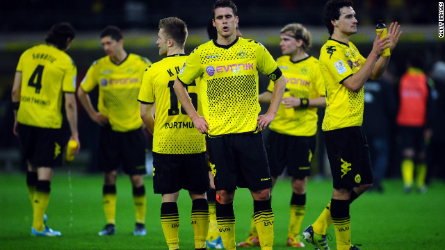 Borussia Dortmund's players react after the end of their 4-4 home draw to Stuttgart in the Bundesliga.