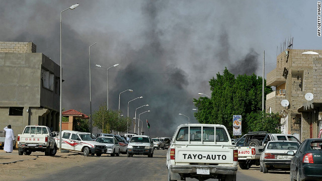 Smoke rises from a road Sabha as fresh clashes between the Toubou tribe and Arab tribesmen from Sabah broke out. 