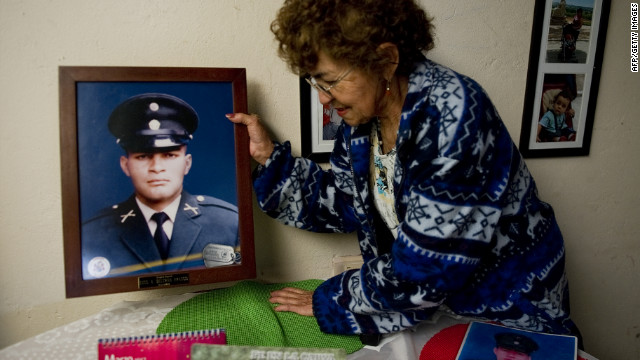 Maria Virginia Franco, mother of FARC hostage Army Sgt. Luis Alfonso Beltran Franco, holds a picture of her son on Friday.